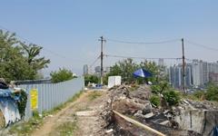 공포의 '쓰레기 산'  정화 위한 첫 삽질 시작