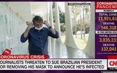 코로나19 확진 브라질 대통령, 언론인에 고발 당하나