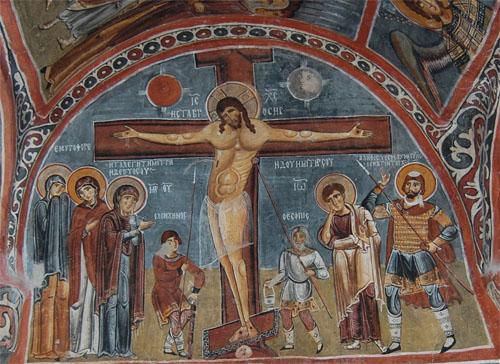 예수의 십자가 처형 카파도키아 암굴교회의 그림이다. 십자가 주변의 두 사람이 창과 긴 막대기로 예수를 찌르고 간지럽히는 것 같다. 마리아는 슬픔에 잠겼다.