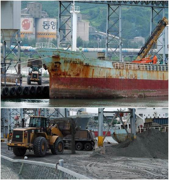 동이 트는 이른 새벽 일본에서 실어 온 석탄재를 시멘트공장으로 운반하기 위해 하역 중입니다.