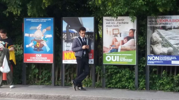 스위스 버스 정류장 앞에 붙어 있는 국민투표 포스터. 스위스는 이달 5일 기본 소득 외에도 연방정부 안 5건을 대상으로 국민투표를 한다.