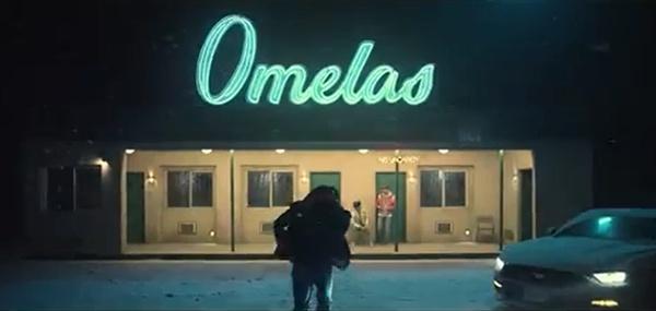 방탄소년단 '봄날' 뮤직비디오 중 '오멜라스'라고 적힌 간판이 눈에 띈다.