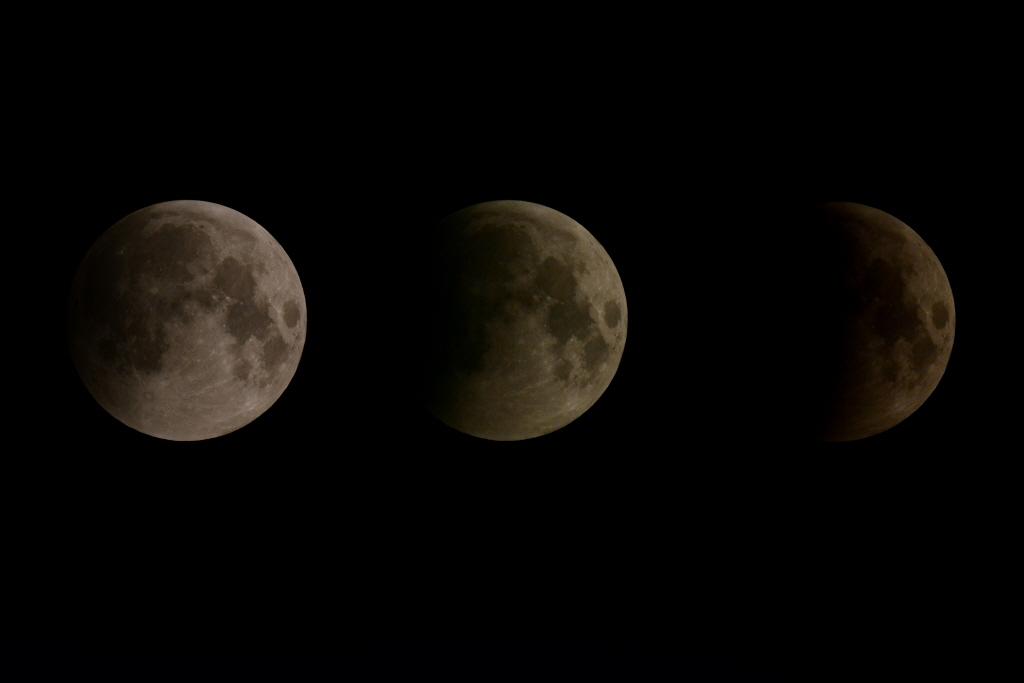 월식 과정 지구의 그림자에 달이 점차 가려지고 있다.