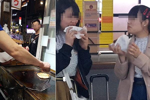 신오쿠보에서 파는 호떡과 이를 맛있게 먹고 있는 일본 여학생들.