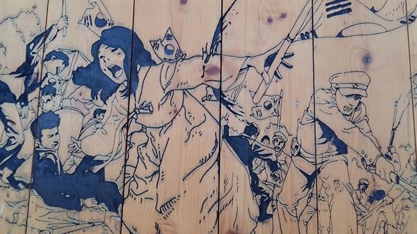 '광주만세운동길'에 있는 벽화에는 만세운동 선봉에 섰던 윤형숙 열사의 모습이 묘사돼 있다