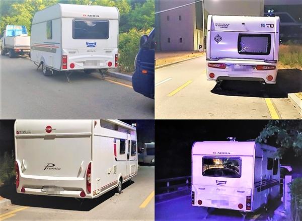 불법주차되어 있는 캠핑카들 동네 이면도로 곳곳에 캠핑카와 트레일러들이 장기 불법주차되어 있다.