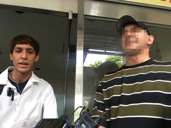 김민혁군과 그의 아버지 A씨가 취재진의 질문에 대답을 하고 있다.