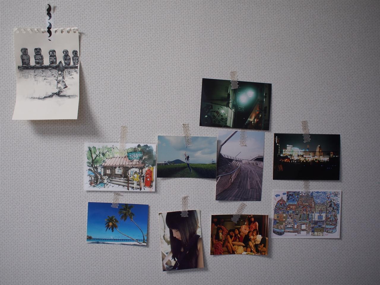 내 방의 벽에는 좋았던 여행지와 좋았던 시절, 그리고 사촌동생의 그림이 붙어있다