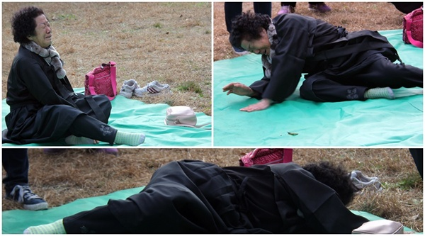 한 유가족이 설움과 고통이 밀려오는 듯 가슴을 치다 바닥을 뒹굴며 통곡하고 있다.