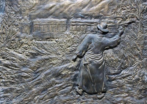원태우 지사 의거지' 표석에 새겨져 있는 의사의 투석 장면 부조