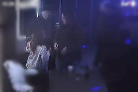 광주 북구의 한 노래방 CCTV에 담긴 2019년 12월 26일 전남대학교 산학협력단 송년회 모습. 오후 10시 29분 A과장이 C직원이 바라보는 와중에 B직원의 어깨를 눌러 주저앉히고 있다.