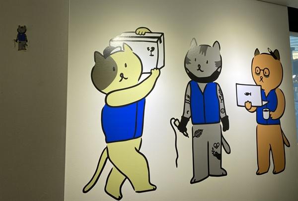 """뉴워커의 마스코트 민주노총은 뉴워커의 마스코트를 '고양이'로 삼은 이유를 """"종석적이지 않기 때문""""이라고 설명했다."""