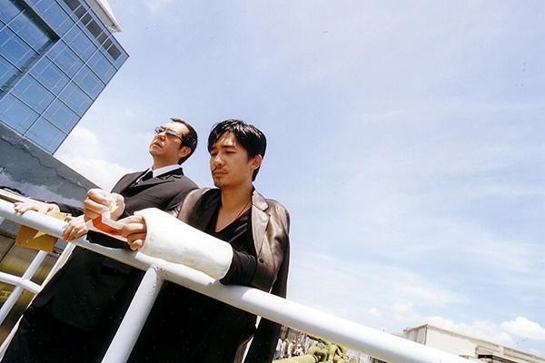 황추생(왼쪽)은 <무간도>를 비롯한 여러 영화에서 선역과 악역을 넘나들며 다양한 캐릭터를 연기했다.